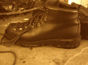 danner boot by fireplace