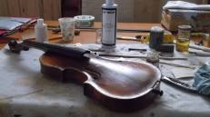 multiple repairs to an old violin