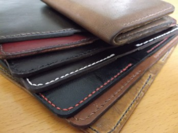 Stack of RO-ARK bifold card cases