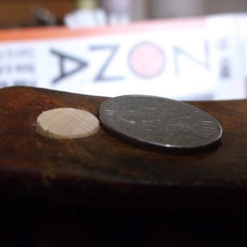 zona saw trims violin bushing peg dime close